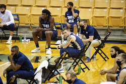 Oral Roberts players watch the final minutes of a loss to Missouri in an NCAA college basketball game Wednesday, Nov. 25, 2020, in Columbia, Mo. (AP Photo/L.G. Patterson)