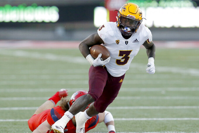 Arizona State running back Eno Benjamin (3) carries the ball in the second half during an NCAA college football game against Arizona, Saturday, Nov. 24, 2018, in Tucson, Ariz. The Sun Devils have nothing to worry about at running back with Eno Benjamin in the backfield. He set a school record with 1,642 yards rushing _ fifth nationally _ and was a third-team Associated Press All-American in 2018. (AP Photo/Rick Scuteri)