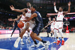 Georgetown guard Terrell Allen (12) loses the ball as he collildes with St. John's guard Greg Williams Jr. (4) during the first half of an NCAA basketball game, Sunday, Feb. 2, 2020, in New York. (AP Photo/Kathy Willens)