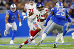 New York Giants wide receiver Golden Tate (15) attempts to avoid Detroit Lions defensive back Will Harris (25) during the first half of an NFL football game, Sunday, Oct. 27, 2019, in Detroit. (AP Photo/Paul Sancya)