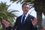 FILE - In this Tuesday, June 15, 2021, file photo, California Gov. Gavin Newsom talks during a news conference at Universal Studios in Universal City, Calif. Newsom and state legislative leaders are negotiating about whether to extend the state's ban on evictions for unpaid rent. California's eviction protections will expire on June 30. Newsom has proposed using federal coronavirus aid money to pay off 100% of the rent people owe. (AP Photo/Ringo H.W. Chiu, File)