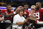 "Alabama players put the ""Old Leather Helmet"" on head coach Nick Saban after defeating Duke 42-3 in the Chick-fil-A Kickoff NCAA college football, Saturday, Aug. 31, 2019, in Atlanta. (AP Photo/John Bazemore)"