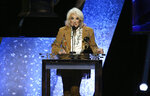 Tanya Tucker accepts the award for best country song for