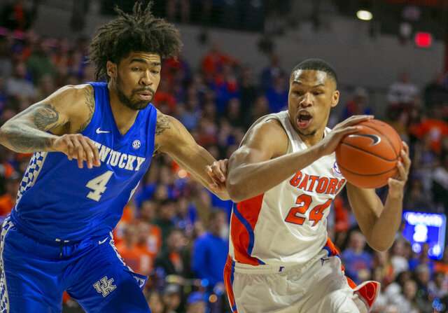 Florida forward Kerry Blackshear Jr. (24) drives ato the basket against Kentucky forward Nick Richards (4) during the first half of an NCAA college basketball game Saturday, March 7, 2020, in Gainesville, Fla. (AP Photo/Alan Youngblood)