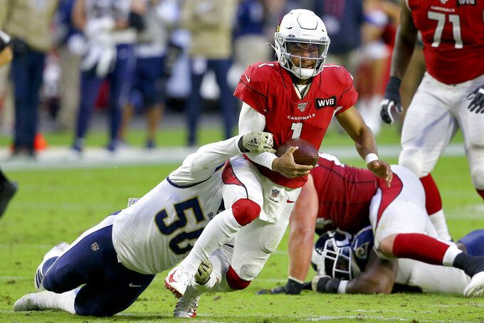 Arizona Cardinals quarterback Kyler Murray (1) is tackled by Los Angeles Rams outside linebacker Samson Ebukam (50) during the second half of an NFL football game, Sunday, Dec. 1, 2019, in Glendale, Ariz. (AP Photo/Ross D. Franklin)