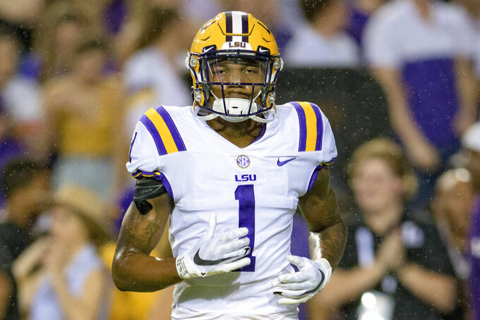 FILE- In this Saturday, Oct. 2, 2021, file photo, LSU cornerback Eli Ricks (1) runs on the field during an NCAA college football game against Auburn in Baton Rouge, La. Ricks has decided to have season ending surgery to repair an injury that has nagged him for much of the season, coach Ed Orgeron said Wednesday, Oct. 13, 2021. (AP Photo/Matthew Hinton, File)