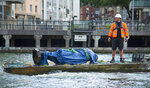 In this photograph made available by Bristol City Council, the statue of Edward Colston is recovered from the harbour in Bristol, Thursday June 11, 2020, after it was toppled by anti-racism protesters on Sunday. The council says it has been taken to a