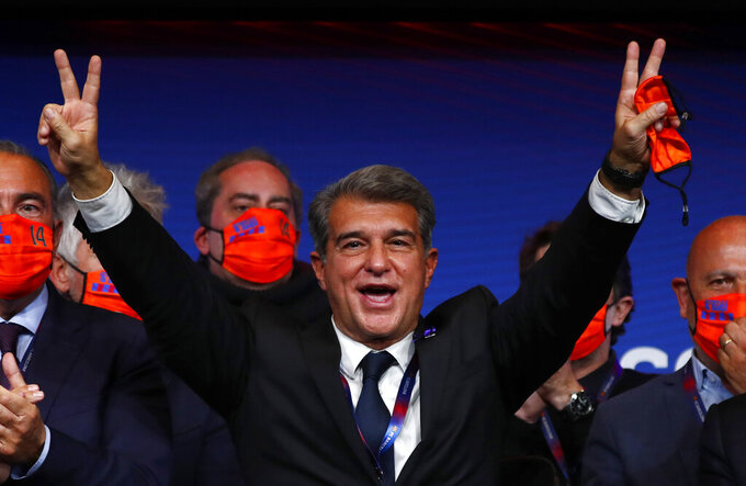 Joan Laporta celebrates his victory after elections at the Camp Nou stadium in Barcelona, Spain, Sunday, March 7, 2021. Joan Laporta has been elected Barcelona's president on Sunday, inheriting a club mired in debt and facing daunting problems that include the possible departure of Messi when his contract ends at the end of the season. (AP Photo/Joan Monfort)