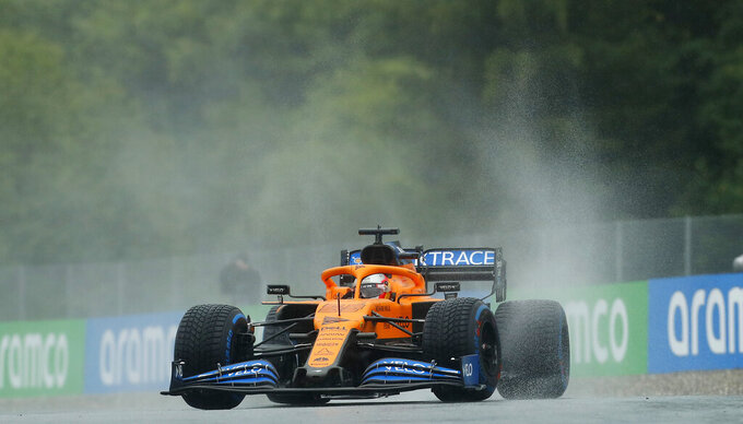 Mclaren driver Carlos Sainz of Spain steers his car during the qualifying session for the Styrian Formula One Grand Prix at the Red Bull Ring racetrack in Spielberg, Austria, Saturday, July 11, 2020. The Styrian F1 Grand Prix will be held on Sunday. (AP Photo/Darko Bandic, Pool)