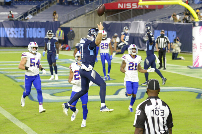 Tennessee Titans quarterback Ryan Tannehill (17) leaps into the end zone as he scores a touchdown against the Buffalo Bills on a 10-yard run in the first half of an NFL football game Tuesday, Oct. 13, 2020, in Nashville, Tenn. (AP Photo/Mark Zaleski)