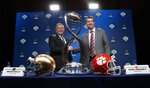 Notre Dame head coach Brian Kelly, left, and Clemson head coach Dabo Swinney shake hands and pose for photos after the NCAA Cotton Bowl football coaches' news conference in Dallas, Friday, Dec. 28, 2018. Notre Dame is scheduled to play Clemson in the NCAA Cotton Bowl semi-final playoff Saturday. (AP Photo/LM Otero)