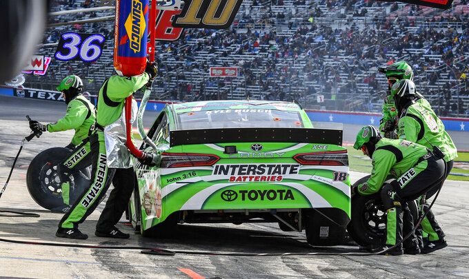 Driver Kyle Busch's pit crew service his car after he collided with the wall during a NASCAR Cup auto race at Texas Motor Speedway, Sunday, March 31, 2019, in Fort Worth, Texas. (AP Photo/Larry Papke)