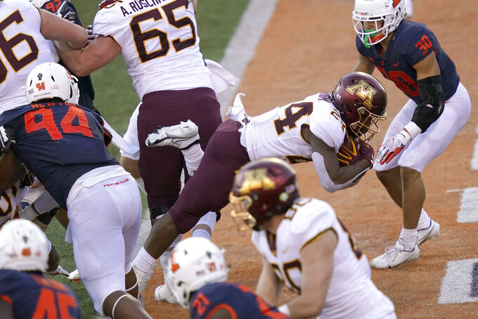 Minnesota running back Mohamed Ibrahim dives into the end zone for a touchdown during the first half of an NCAA college football game against Illinois Saturday, Nov. 7, 2020, in Champaign , Ill. (AP Photo/Charles Rex Arbogast)