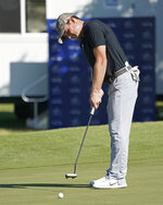 John Peterson putts on the ninth green during the second round of the Sony Open golf tournament, Friday, Jan. 12, 2018, in Honolulu. (AP Photo/Marco Garcia)