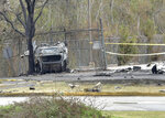 A view of a damaged vehicle near the site of a plane crash near Feu Follet Road and Verot School Road in Lafayette, La., Saturday, Dec. 28, 2019.  Authorities confirmed the accident but details on whether anyone was injured was not immediately known.(Scott Clause/The Lafayette Advertiser via AP)