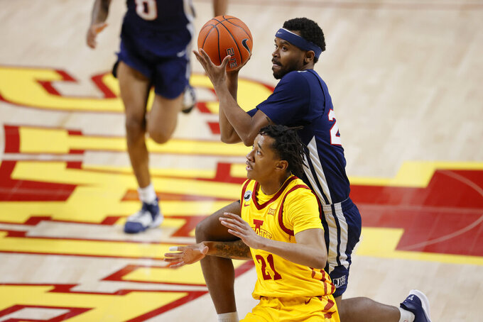 Jackson State guard Micheal Tate, top, shoots over Iowa State guard Jaden Walker during the first half of an NCAA college basketball game, Sunday, Dec. 20, 2020, in Ames, Iowa. (AP Photo/Matthew Putney)
