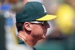 Oakland Athletics manager Bob Melvin watches his team take on the Texas Rangers during the second inning of a baseball game Sunday, Sept. 22, 2019, in Oakland, Calif. (AP Photo/D. Ross Cameron)