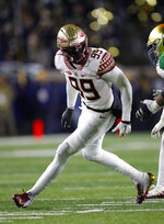 FILE - In this Nov. 10, 2018, file photo, Florida State defensive end Brian Burns plays against Notre Dame in the second half of an NCAA college football game, in South Bend, Ind. Florida State's Brian Burns, Boston College's Wyatt Ray and Syracuse's Alton Robinson are tied for eighth in sacks with nine each. (AP Photo/Paul Sancya, File)
