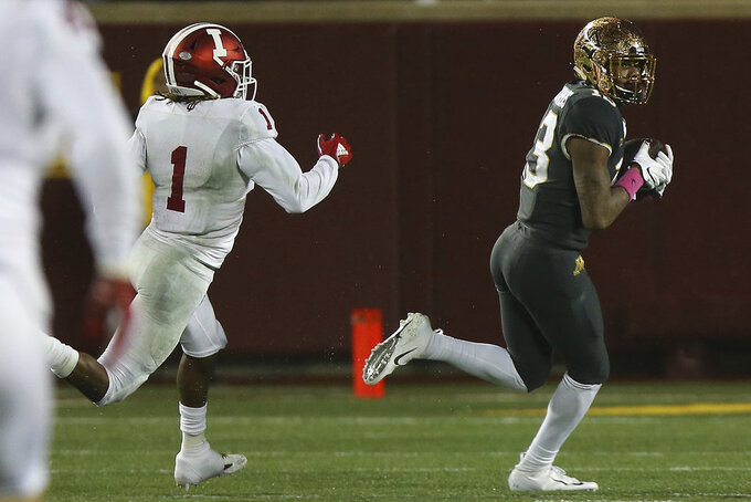 Minnesota wide receiver Rashod Bateman runs with the ball to score the game-winning touchdown against Indiana's Juwan Burgess during an NCAA college football game Friday, Oct. 26, 2018, in Minneapolis. Minnesota won 38-31. (AP Photo/Stacy Bengs)