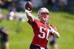 New England Patriots quarterback Mac Jones throws a pass during an NFL football practice, Friday, July 30, 2021, in Foxborough, Mass. (AP Photo/Elise Amendola)