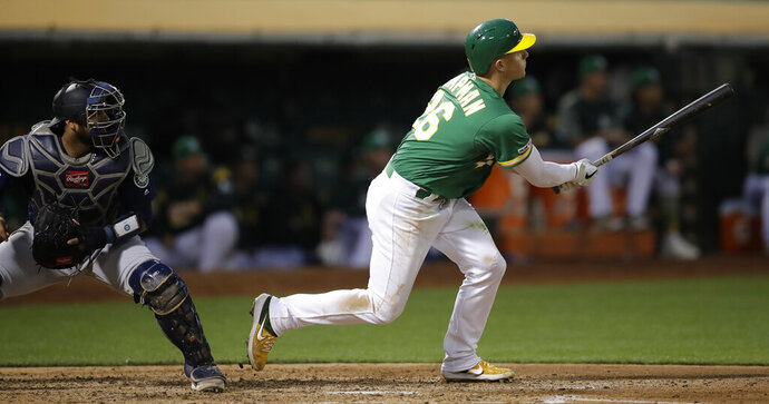 Oakland Athletics' Matt Chapman watches his two-run home run off Seattle Mariners' Marco Gonzales during the fifth inning of a baseball game Tuesday, July 16, 2019, in Oakland, Calif. (AP Photo/Ben Margot)