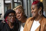 Ketra Veasy, right, sister of Willie Veasy, who has been imprisoned for 27 years for a murder he insists he did not commit, smiles in relief along with Debra Chappell, center, and Bonnie Marell, mother of Willie Veasy, outside of the Center for Criminal Justice Wednesday, Oct. 9, 2019 in Philadelphia. Willie Veasy who has maintained his innocence in a murder case for nearly three decades has been ordered freed from prison after a judge overturned his conviction. (Heather Khalifa/The Philadelphia Inquirer via AP)
