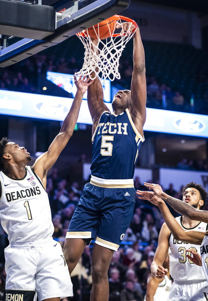 Georgia Tech forward Moses Wright (5) dunks over Wake Forest forward Isaiah Mucius (1) during an NCAA college basketball game Wednesday, Feb. 19, 2020, in Winston-Salem, N.C. (Andrew Dye/The Winston-Salem Journal via AP)