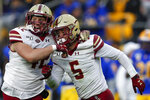 Boston College defensive back Nolan Borgersen (5) celebrates with linebacker Vinny DePalma (42) after recovering a Pittsburgh fumble during the first half of an NCAA college football game, Saturday, Nov. 30, 2019, in Pittsburgh. (AP Photo/Keith Srakocic)