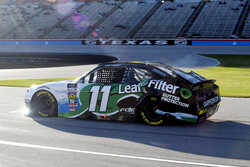 Justin Haley heads down pit road after crashing during qualifying for the NASCAR Xfinity Series auto race at Texas Motor Speedway in Fort Worth, Texas, Saturday, Nov. 2, 2019. (AP Photo/Randy Holt)