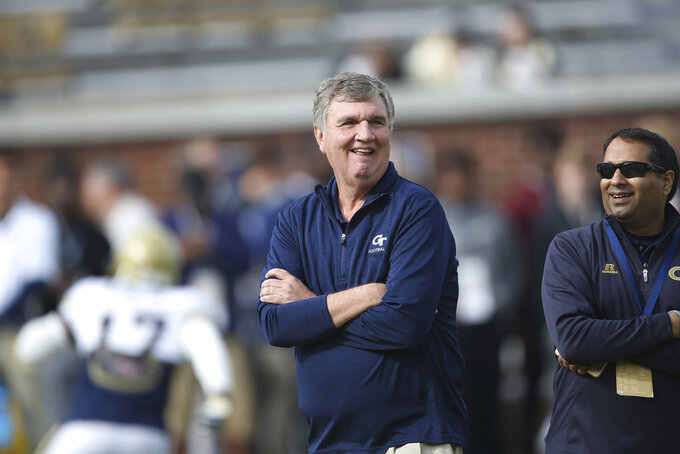 FILE - In this Nov. 25, 2017, file photo, Georgia Tech head coach Paul Johnson watches his team warm up before an NCAA college football game against Georgia in Atlanta. A person familiar with the decision tells The Associated Press that Johnson is retiring. The person spoke on condition of anonymity on Wednesday, Nov. 28, 2018, because the school had not made an official announcement. (AP Photo/John Bazemore, File)