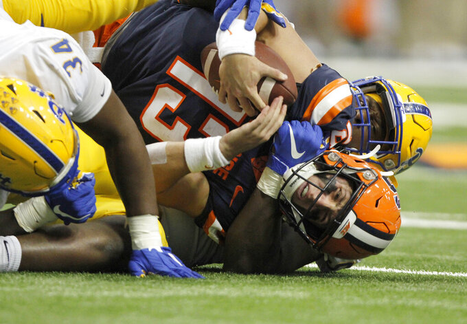 Syracuse's Tommy DeVito, bottom, is sacked by Pittsburgh's Deslin Alexandre during the third quarter of an NCAA college football game in Syracuse, N.Y., Friday, Oct. 18, 2019. (AP Photo/Nick Lisi)