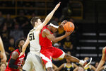 Nebraska guard Glynn Watson Jr. grabs a rebound in front of Iowa forward Nicholas Baer, left, during the first half of an NCAA college basketball game, Sunday, Jan. 6, 2019, in Iowa City, Iowa.(AP Photo/Charlie Neibergall)