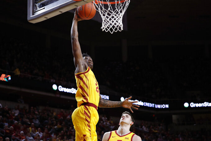 Iowa State guard Terrence Lewis breaks away for a dunk against Florida A&M during the first half of an NCAA college basketball game Tuesday, Dec. 31, 2019, in Ames, Iowa. (AP Photo/Matthew Putney)