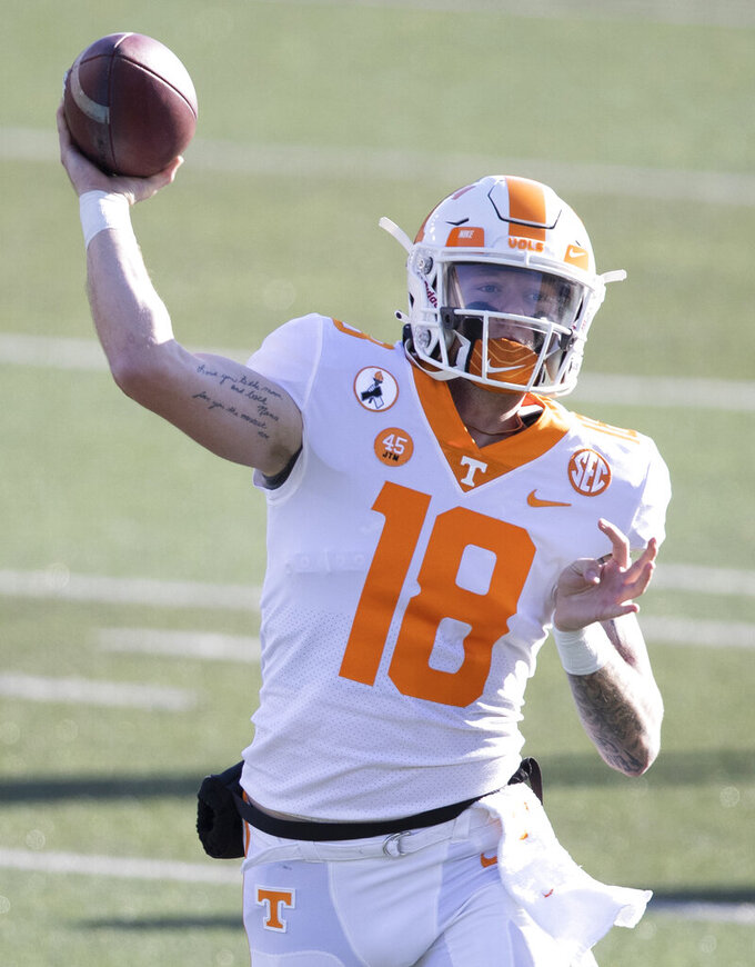 Tennessee quarterback Brian Maurer (18) throws during warmups before an NCAA college football game against Vanderbilt, Saturday, Dec. 12, 2020, in Nashville, Tenn. (AP Photo/Wade Payne)