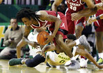 Alabama guard John Petty (23) pulls in a loose ball over Baylor forward Flo Thamba (0)  during the first half of an NCAA college basketball game, Saturday, Jan. 26, 2019, in Waco, Texas. (Rod Aydelotte/Waco Tribune-Herald via AP)
