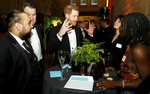 Britain's Prince Harry talks with guests during the global premiere of Netflix's