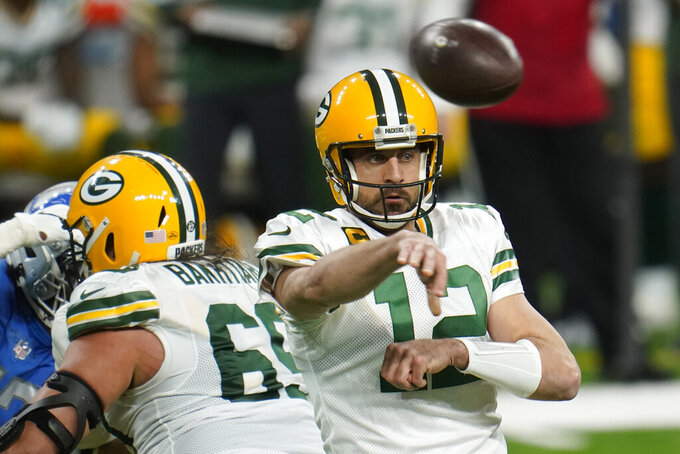 Green Bay Packers quarterback Aaron Rodgers throws during the first half of an NFL football game against the Detroit Lions, Sunday, Dec. 13, 2020, in Detroit. (AP Photo/Paul Sancya)