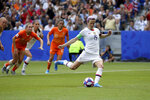 FILE - In this July 7, 2019, file photo, United States' Megan Rapinoe scores her side's opening goal from a penalty shot during the Women's World Cup final soccer match against The Netherlands at the Stade de Lyon in Decines, outside Lyon, France. Twenty players have been named to the U.S. women's soccer team that will play for a spot in the Tokyo Olympics. Coach Andonovski announced the roster for the CONCACAF Olympic qualifying tournament Friday, Jan. 17, 2020. (AP Photo/David Vincent, File)
