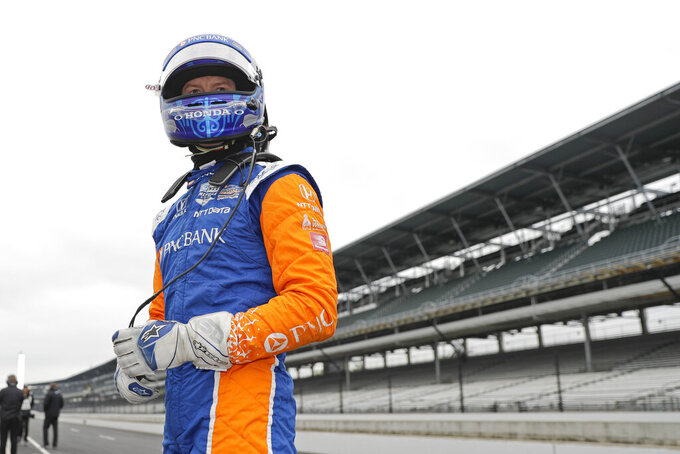 Scott Dixon, of New Zealand, waits during a practice session for the Indy GP IndyCar auto race at Indianapolis Motor Speedway, Friday, May 10, 2019 in Indianapolis. (AP Photo/Darron Cummings)