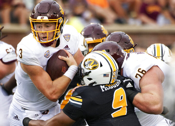 Central Michigan quarterback Jacob Sirmon, left, is tackled by Missouri's Isaiah McGuire, front right, during the fourth quarter of an NCAA college football game Saturday, Sept. 4, 2021, in Columbia, Mo. (AP Photo/L.G. Patterson)