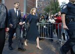 Felicity Huffman leaves federal court with her husband William H. Macy after she was sentenced in a nationwide college admissions bribery scandal, Friday, Sept. 13, 2019, in Boston. (AP Photo/Michael Dwyer)