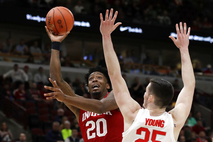 Indiana's De'Ron Davis (20) shoots over Ohio State's Kyle Young (25) during the first half of an NCAA college basketball game in the second round of the Big Ten Conference tournament, Thursday, March 14, 2019, in Chicago. (AP Photo/Nam Y. Huh)