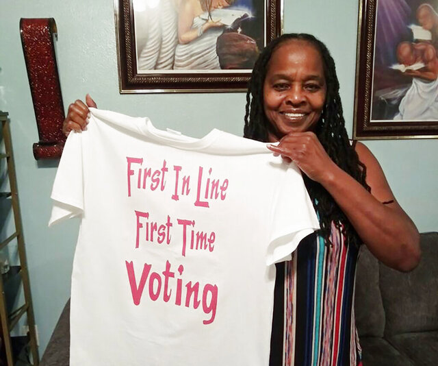 In this photo taken by her son, Betty Riddle in Sarasota, Fla., Sunday, April 26, 2020, holds the T-shirt she wore on March 17, 2020, when she voted for the first time. She was barred from voting in Florida until a federal judge temporarily blocked the state from preventing her and 16 other felons from voting because of unpaid legal financial obligations. (Courtesy of Rickie Riddle via AP)