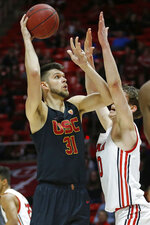 Utah forward Mikael Jantunen, right, defends as USC forward Nick Rakocevic (31) shoots in the first half of an NCAA college basketball game Sunday, Feb. 23, 2020, in Salt Lake City. (AP Photo/Rick Bowmer)
