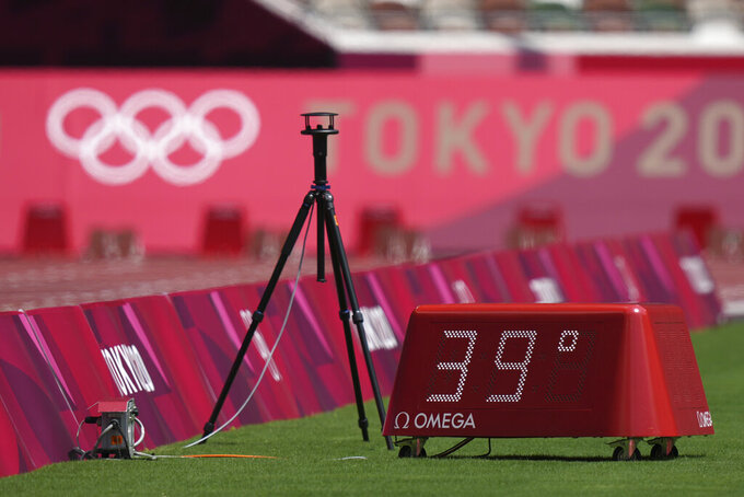 Temperature on the field during the athletics at the 2020 Summer Olympics, Sunday, Aug. 1, 2021, in Tokyo. (AP Photo/Matthias Schrader)