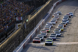Ryan Blaney, front right, and Denny Hamlin, front left, lead the start of a NASCAR Cup Series auto race Sunday, Sept. 5, 2021, in Darlington, S.C. (AP Photo/John Amis)