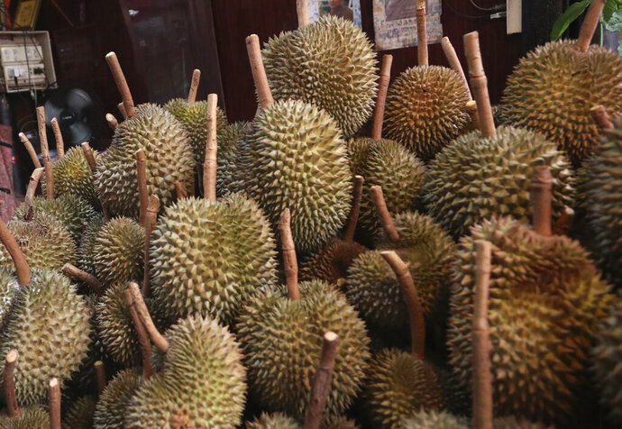 FILE - This Sept. 3, 2019, file photo shows durians for sale in Bangkok. Police in Hawaii are investigating the theft of fruit valued at about $1,000 including durian, which is known for its powerful odor. Two men entered a property in Hilo on the Big Island and removed 18 durian and other types of fruit on the night of Feb. 1, 2020, the Hawaii Police Department said. (AP Photo/Sakchai Lalit, File)