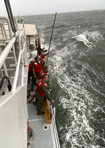 In this photo provided by the U.S. Coast Guard, crew members of the Coast Guard Cutter Glenn Harris search for survivors Tuesday, April 13, 2021 after a 175-foot commercial lift boat capsized 8 miles south of Grand Isle, La. The Seacor Power, an oil industry vessel, flipped over Tuesday in a microburst of dangerous wind and high seas. (U.S. Coast Guard via AP)