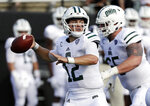 FILE - In this Saturday, Sept. 15, 2018, file photo, Ohio quarterback Nathan Rourke (12) passes against Virginia in the first half of an NCAA college football game in Nashville, Tenn.  The Bobcats have gone 9-4 and have won bowl games each of the last two seasons. Quarterback Nathan Rourke threw for 2,434 yards and 23 touchdowns and rushed for 860 yards and 15 scores last season. (AP Photo/Mark Humphrey, File)