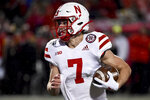 Nebraska quarterback Luke McCaffrey (7) runs the ball during the second half of an NCAA college football game against Maryland, Saturday, Nov. 23, 2019, in College Park, Md. (AP Photo/Will Newton)